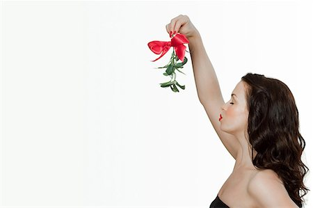 Young woman blowing a kiss Stock Photo - Premium Royalty-Free, Code: 614-03507552