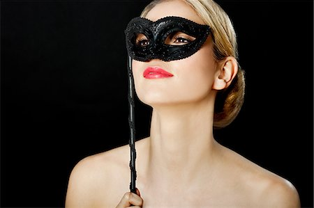 Young blonde woman wearing with black mask Stock Photo - Premium Royalty-Free, Code: 614-03507599