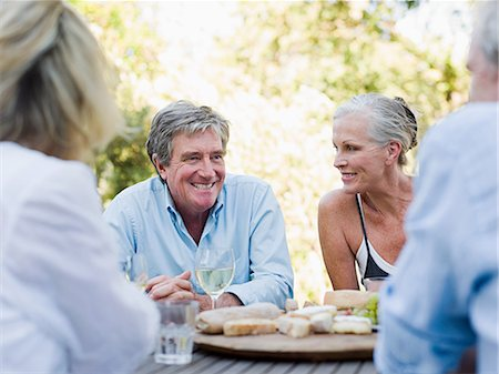 Friends at meal outdoors Stock Photo - Premium Royalty-Free, Code: 614-03551645