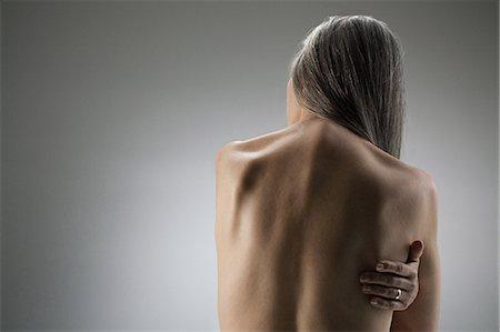 Topless senior woman, rear view Stock Photo - Premium Royalty-Free, Code: 614-03551881