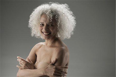 Mature woman wearing pink bra Stock Photo - Premium Royalty-Free, Code: 614-03551896