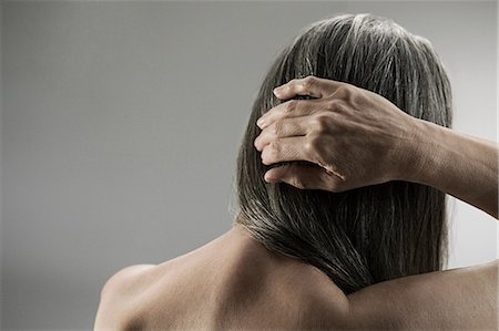 Topless senior woman, rear view Stock Photo - Premium Royalty-Free, Code: 614-03551890