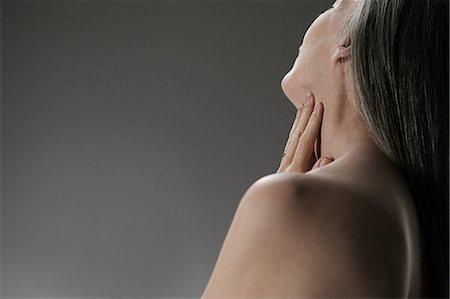 Topless senior woman, rear view Stock Photo - Premium Royalty-Free, Code: 614-03551911