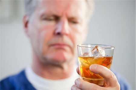 Man with glass of whisky Stock Photo - Premium Royalty-Free, Code: 614-03552279