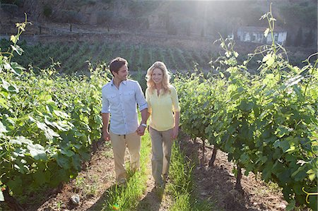 Couple in a sunlit vineyard Stock Photo - Premium Royalty-Free, Code: 614-03552327