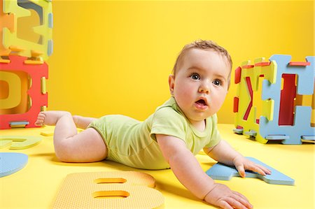 Baby boy playing with toy alphabet letters Stock Photo - Premium Royalty-Free, Code: 614-03576705