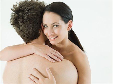 Nude couple embracing Stock Photo - Premium Royalty-Free, Code: 614-03647993