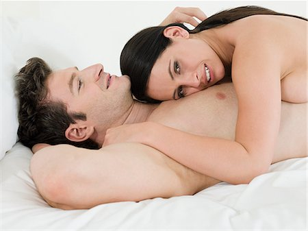 Young couple lying on bed Stock Photo - Premium Royalty-Free, Code: 614-03648000