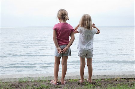 Two little girls by the sea Stock Photo - Premium Royalty-Free, Code: 614-03648734