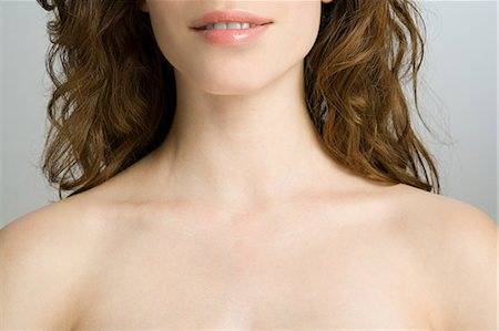 female nud - Cropped head and shoulders of a young woman Stock Photo - Premium Royalty-Free, Code: 614-03649028