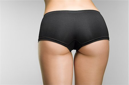 Woman wearing knickers Stock Photo - Premium Royalty-Free, Code: 614-03649035