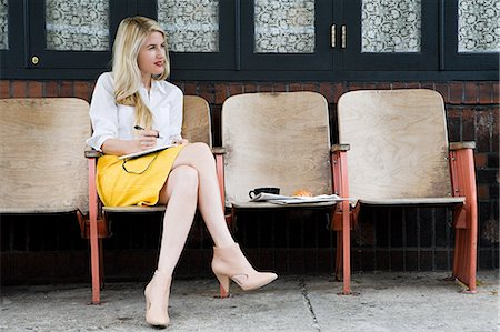 street cafe day - Woman sitting outside cafe and writing Stock Photo - Premium Royalty-Free, Code: 614-03649636