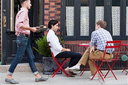 street cafe day - Waiter bringing coffee to men outside cafe Stock Photo - Premium Royalty-Free, Code: 614-03649641