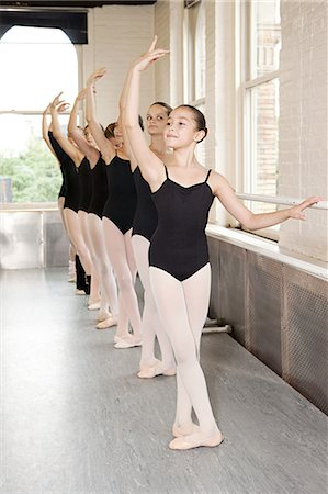 Ballerinas in pose at barre Stock Photo - Premium Royalty-Free, Code: 614-03684365