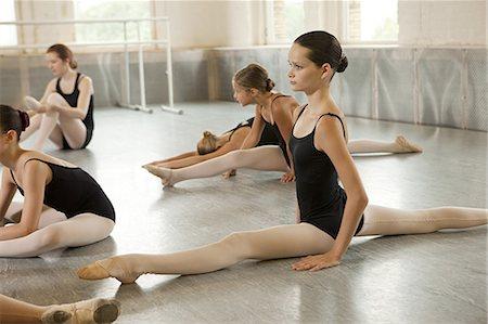 Ballerinas doing the splits Stock Photo - Premium Royalty-Free, Code: 614-03684367