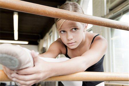 preteen girls stretching - Ballerina stretching Stock Photo - Premium Royalty-Free, Code: 614-03684383