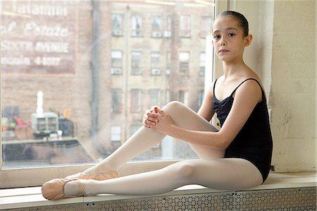 Ballerina sitting on windowsill Stock Photo - Premium Royalty-Free, Code: 614-03684438