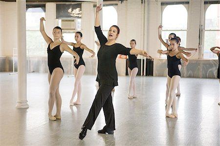 Teacher and ballet dancers Stock Photo - Premium Royalty-Free, Code: 614-03684439