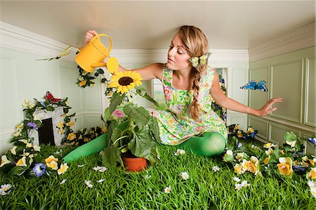 quirky - Young woman with garden in small room Stock Photo - Premium Royalty-Free, Code: 614-03684534