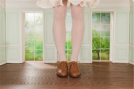 Legs of giant woman in tiny room Stock Photo - Premium Royalty-Free, Code: 614-03684592