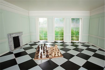 quirky - Big chess set in small room Stock Photo - Premium Royalty-Free, Code: 614-03684606