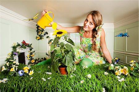Young woman with garden in small room Stock Photo - Premium Royalty-Free, Code: 614-03684602