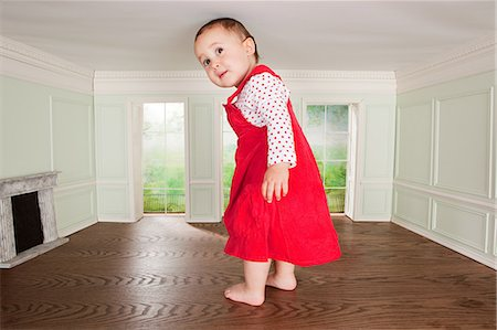 Big toddler girl in a tiny room Stock Photo - Premium Royalty-Free, Code: 614-03684603