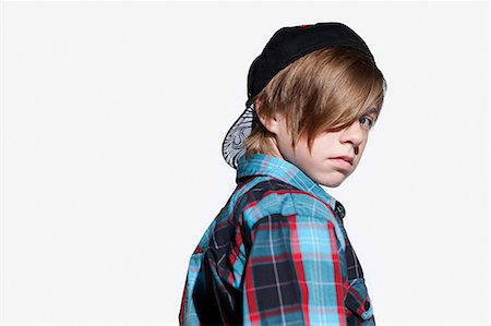 Teenage boy looking over shoulder Stock Photo - Premium Royalty-Free, Code: 614-03684792