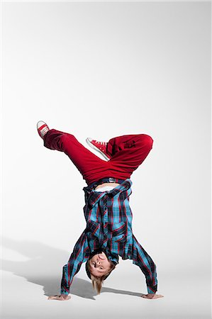 Teenage boy doing a handstand Stock Photo - Premium Royalty-Free, Code: 614-03684804