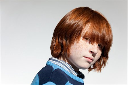 preteen long hair - Portrait of boy with red hair Stock Photo - Premium Royalty-Free, Code: 614-03684828