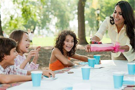 Children at birthday party with birthday cake Stock Photo - Premium Royalty-Free, Code: 614-03697225
