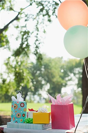 Outdoor birthday party with balloons Stock Photo - Premium Royalty-Free, Code: 614-03697248