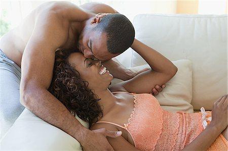 Intimate couple on sofa Stock Photo - Premium Royalty-Free, Code: 614-03697310