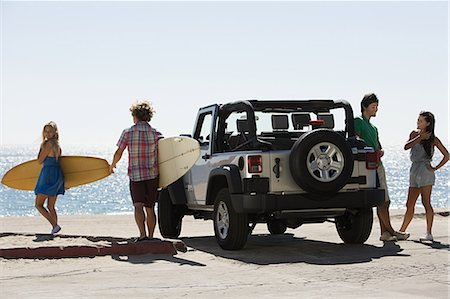Friends by vehicle with surfboards Stock Photo - Premium Royalty-Free, Code: 614-03697600