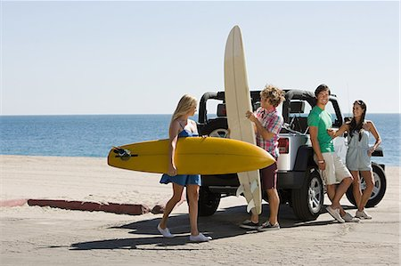 Friends by vehicle with surfboards Stock Photo - Premium Royalty-Free, Code: 614-03697647