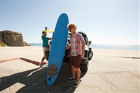 Two young men with surfboards Stock Photo - Premium Royalty-Free, Code: 614-03697649