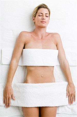 Young woman having body treatment Stock Photo - Premium Royalty-Free, Code: 614-03763557