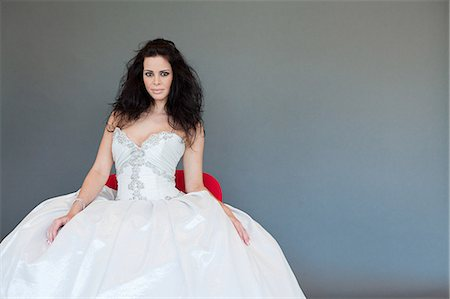 Young woman wearing white wedding dress, studio shot Stock Photo - Premium Royalty-Free, Code: 614-03763852