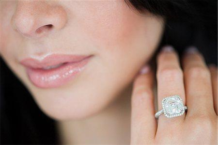 diamond - Young woman wearing engagement ring Stock Photo - Premium Royalty-Free, Code: 614-03763868