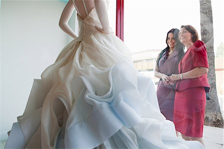 Mother and daughter looking at wedding dress in shop window Stock Photo - Premium Royalty-Free, Code: 614-03763869
