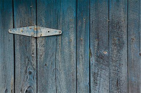 painted - Blue painted wooden door with hinge Stock Photo - Premium Royalty-Free, Code: 614-03763961