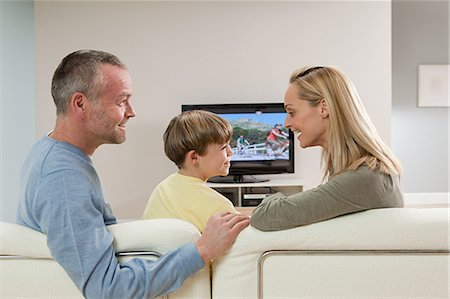 Family watching television Stock Photo - Premium Royalty-Free, Code: 614-03784136