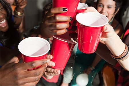 Young people with plastic cups at party Stock Photo - Premium Royalty-Free, Code: 614-03818506