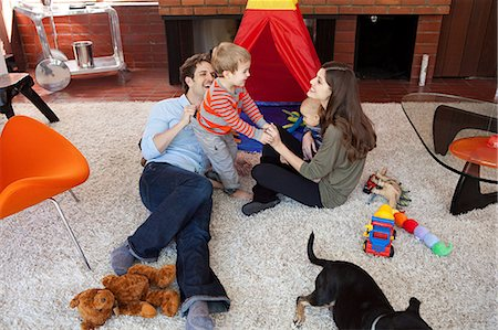 Family playing in living room Stock Photo - Premium Royalty-Free, Code: 614-03818600