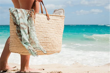 Woman carrying beach bag, Mustique, Grenadine Islands Stock Photo - Premium Royalty-Free, Code: 614-03902671
