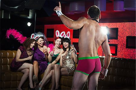 Young women on hen night with male stripper Stock Photo - Premium Royalty-Free, Code: 614-03902689