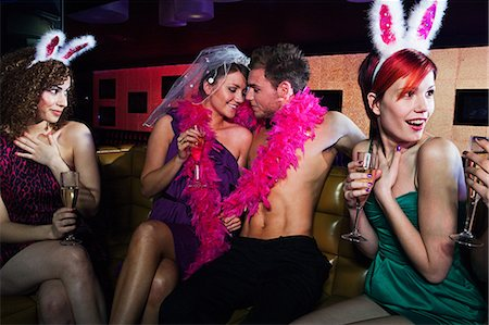 Young women on hen night with male stripper Stock Photo - Premium Royalty-Free, Code: 614-03902705