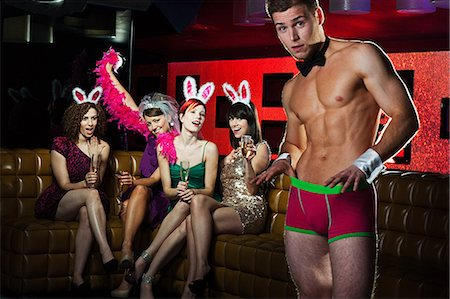 shirtless men - Young women on hen night with male stripper Stock Photo - Premium Royalty-Free, Code: 614-03902701