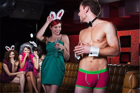 Young women on hen night with male stripper Stock Photo - Premium Royalty-Free, Code: 614-03902725