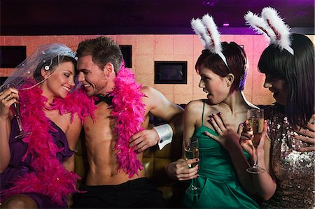 Young women on hen night with male stripper Stock Photo - Premium Royalty-Free, Code: 614-03902737